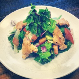 Chicken salad with colored chard, tomato, lettuce, onion, fresh herbs and ACV.