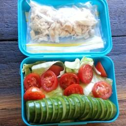 Picnic food - chicken, cucumber, tomato, lettuce