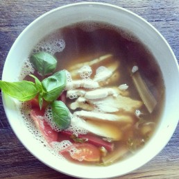 Hot and sour soup with poached chicken - coloured chard leaves and stems, leek, tomato, basil, mint, ginger, sumac, poached chicken.