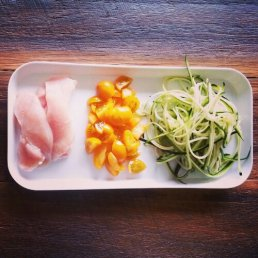 Chicken stir fry ingredients: Chicken, zucchini, yellow cherry tomatoes