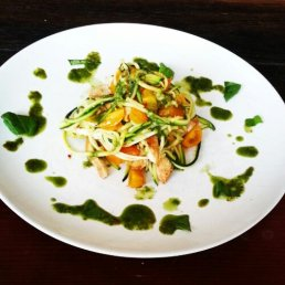 Chicken stir fry with zucchini noodles, yellow cherry tomatoes and a chilli basil dressing