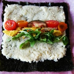 Adding fillings to the cauliflower rice and nori