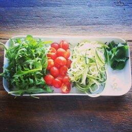 Zucchini pasta ingredients: Zucchini, tomatoes, rocket, basil, garlic