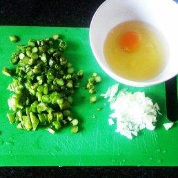 Omelette ingredients: onion, asparagus, 3 egg whites, 1 egg yolk.