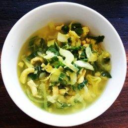 Chicken soup with bok choy, leek, rocket, onion, garlic