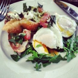 Eggs with avocado, tomato rocket and feta from Harvest Foodstore and Cafe