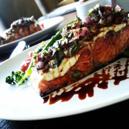 Salmon, with tahini, nuts fresh herbs and Spanish onion. with a side of well oiled vegetables