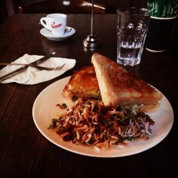 Chicken sourdough toastie with avocado and cheese with a side of wild rice salad with cranberries, almonds coriander and spring onions.